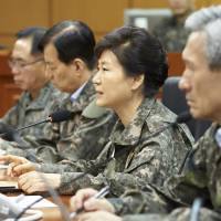South Korean President Park Geun-hye (center) speaks during her visit to a military command post in Yongin on Friday after North Korean leader Kim Jong Un ordered his troops onto a war footing earlier the same day. | REUTERS