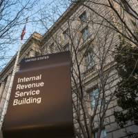 The Internal Revenue Service Headquarters (IRS) building is seen in Washington in April 2014. The IRS says thieves used an agency website to steal tax information from as many as 220,000 additional taxpayers. The agency first disclosed the breach in May. Monday's revelation more than doubles the total number of potential victims, to 334,000. | AP