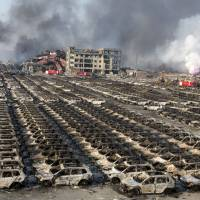 Military team combs site of Tianjin blasts fatal to 50 as questions abound, officials clam up