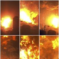 These images taken from video show a warehouse exploding in Tianjin, China, on Aug. 12. | AP