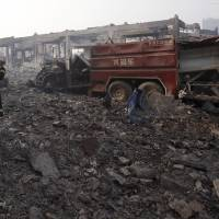 Emergency services personnel hold minute of silence for Tianjin blast victims