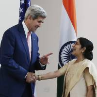 U.S. Secretary of State John Kerry shakes hands with India's External Affairs Minister Sushma Swaraj before the start of their meeting in New Delhi in July 2014. In the weeks leading up to a critical annual U.S. report on human trafficking that publicly shames the world's worst offenders, analysts in the U.S. Office to Monitor and Combat Trafficking in Persons disagreed with U.S. diplomatic bureaus on ratings for 17 countries, according to sources. As a result, Malaysia, Cuba, China, India, Myanmar, Mexico and Greece wound up with better grades than the State Department's human-rights experts wanted to give them.   REUTERS