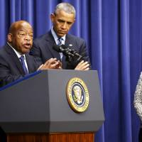 U.S. Rep. John Lewis, a Georgia Democrat, introduces President Barack Obama to speak at a Thursday conference to commemorate the 50th anniversary of the Voting Rights Act at the White House as U.S. Attorney General Loretta Lynch looks on. | REUTERS