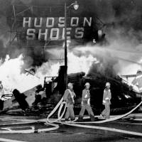 Firefighters battle a blaze in a shoe store during rioting in the Watts district of Los Angeles on Aug. 14, 1965. | AP