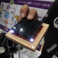 Hidden in the base of the masu is a module equipped with LED lights and an acceleration sensor. | KAZUAKI NAGATA