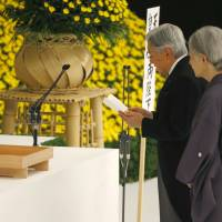 Emperor Akihito delivers his remarks with Empress Michiko during a memorial service at the Nippon Budokan hall in Tokyo on Saturday, the 70th anniversary of the end of World War II.   AP