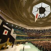 Japan's Emperor Akihito, left, delivers his remarks with Empress Michiko during a memorial service at Tokyo's Nippon Budokan martial arts hall on Saturday as Japan marked the 70th anniversary of the end of World War II. | AP