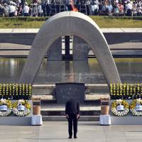 Prime Minister Shinzo Abe bows in front of the memorial cenotaph for victims of a 1945 atomic bombing during a memorial ceremony to mark the 70th anniversary at the Hiroshima Peace Memorial Park on Thursday.  | AFP-JIJI