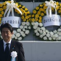 Prime Minister Shinzo Abe attends the ceremony at Peace Memorial Park in Hiroshima on Thursday.   REUTERS