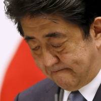 Prime Minister Shinzo Abe delivers a statement marking the 70th anniversary of the war's end at a news conference at his office in Tokyo on Friday. | REUTERS