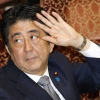 Prime Minister Shinzo Abe attends a budget committee session in the Upper House on Monday. | KYODO