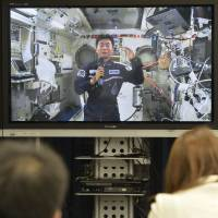 Japanese astronaut Kimiya Yui speaks during a televised news conference from the International Space Station late Tuesday night. | KYODO