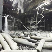 Gas canisters that contained compressed nitrogen, oxygen, Freon, and air are seen strewn about on Monday in a one-story concrete building that partially collapsed after an explosion at the U.S. Army Sagami Depot in Sagamihara, about 40 km southwest of Tokyo.  | AP / U.S. ARMY