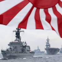 The Maritime Self-Defense Force ship Kurama leads other vessels in October 2012 during a fleet review in Sagami Bay south of Tokyo.   AP