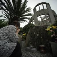 Kimie Mihara, a survivor of the Aug. 6, 1945, atomic bombing in Hiroshima prays at the cenotaph at the Atomic Bomb Dome in Hiroshima on July 3. | AP