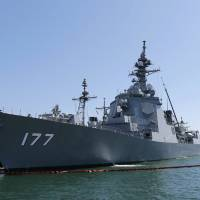 The Maritime Self-Defense Force Aegis destroyer Atago is docked at a U.S. naval base in San Diego in June 2013 for a joint drill. | KYODO