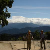 Hikers can often view Mount Fuji from the summit of Mount Takao when the weather is clear. | SATOKO KAWASAKI