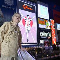 Like iconic sign, confectionery giant Glico sets sights on overseas markets