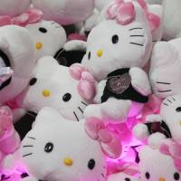 Hello Kitty soft toys are displayed at the Omotesando Hills in Tokyo. The iconic cat is joining a chorus of celebrity peace messages in the runup to Aug. 15. | BLOOMBERG