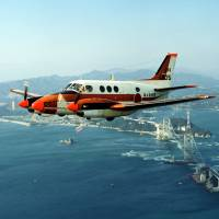 A Maritime Self-Defense Force TC-90 training aircraft is seen in an undated handout photo. | REUTERS