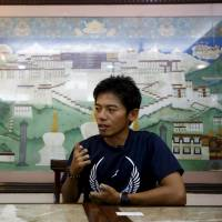 Japanese climber Nobukazu Kuriki speaks during an interview in Kathmandu on Aug. 22, 2015. He set off on his adventure on Aug. 25, leaving Kathmandu for the mountains for acclimatization before tackling Everest next month.   REUTERS