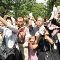 People at Yasukuni Shrine in Tokyo release doves, a symbol of peace, on Saturday morning, the 70th anniversary of the end of World War II.   YOSHIAKI MIURA