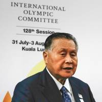 Tokyo 2020 Olympics President Yoshiro Mori is seen at a news conference after he addressed the 128th International Olympic Committee session in Kuala Lumpur on Saturday. | AP