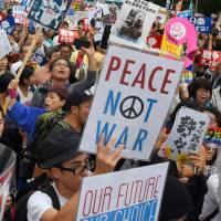 Thousands of people surround the Diet building on Sunday during a protest over a set of controversial security bills being spearheaded by Prime Minister Shinzo Abe. | SATOKO KAWASAKI