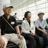 Family members of Japanese who died during and after the end of World War II in what is now North Korea speak to reporters at Tokyo's Haneda airport before flying to Pyongyang on Friday to visit the graves of the deceased. | KYODO
