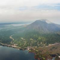 Mount Sakurajima, across the bay from the city of Kagoshima in Kagoshima Prefecture, is seen Saturday. The same day, the Meteorological Agency raised the alert level to 4 and urged nearby residents to be prepared to evacuate as the volcano is showing signs of increased activity. | KYODO