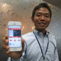 Norifumi Nishio, who heads Lifull Scouting, shows the social networking site that aims to match athletes with teams, at Next Co., the firm's IT parent, on Aug. 12. | KAZUAKI NAGATA