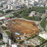 Land is cleared at the site of the New National Stadium in Tokyo's Shinjuku Ward in July. | KYODO