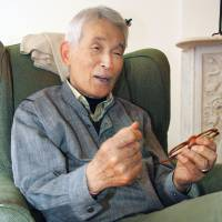 Yasuaki Yamashita talks about his work in recounting his ordeal as a Nagasaki A-bomb survivor, during an interview in New York in April.   KYODO