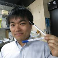 AgIC CEO Shinya Shimizu shows off a marker that can draw an electric circuit on special paper. | KAZUAKI NAGATA