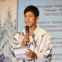 Fuji Television Network announcer Daijiro Enami, who was appointed Japan's tourism ambassador to Thailand, makes a speech during the appointment ceremony in Bangkok on Saturday. | KYODO