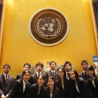 Japanese high school students pose for a photo at the U.N. headquarters in New York while taking part in the Global Classrooms International High School Model U.N. Conference in May. | COURTESY OF ASIA-PACIFIC CULTURAL CENTRE FOR UNESCO / KYODO