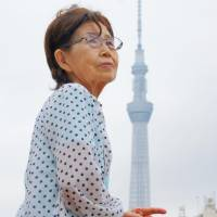 Kimie Nemoto looks up to the sky in Tokyo's Taito Ward in June, recalling the massive U.S. air raids on the capital on March 10, 1945. | KYODO