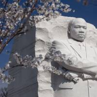 Message for the ages: Cherry trees blossom at the Martin Luther King Jr. Memorial near the Tidal Basin in Washington. | ANDREW HARRER / BLOOMBERG