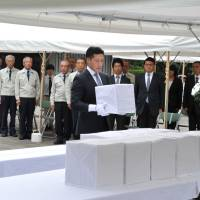 The remains of unidentified Japanese soldiers and civilians are honored at Tokyo's Chidorigafuchi National Cemetery on July 29.    YOSHIAKI MIURA