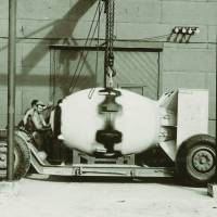 Nuclear first: The atomic bomb nicknamed 'Fat Man' sits on transport carriage on Tinian Island in August 1945. | NATIONAL ARCHIVES