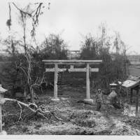 Survivor: The torii gate at Tinian's Hinode Shrine survived the battle in 1944 and still stands. | USMC