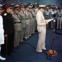 U.S. Gen. Douglas MacArthur speaks at the opening of the surrender ceremonies on board the USS Missouri on Sept. 2, 1945.   ARMY SIGNAL CORPS COLLECTION IN THE U.S. NATIONAL ARCHIVES