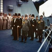 Japanese representatives led by Foreign Minister Mamoru Shigemitsu (front left) and Gen. Yoshijiro Umezu (front right) listen to surrender ceremonies on board the USS Missouri on Sept. 2, 1945. | ARMY SIGNAL CORPS COLLECTION IN THE U.S. NATIONAL ARCHIVES