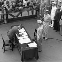 Gen. Yoshijiro Umezu signs the Instrument of Surrender on behalf of Japanese Imperial General Headquarters on board the USS Missouri on Sept. 2, 1945.   ARMY SIGNAL CORPS COLLECTION IN THE U.S. NATIONAL ARCHIVES