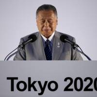 Big talk: Former Prime Minister Yoshiro Mori addresses the media at a news conference on July 24 where Tokyo's Olympic emblems were unveiled.   REUTERS