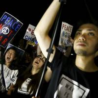 Speaking up: Students shout slogans during a rally denouncing Prime Minister Shinzo Abe's administration outside the Diet in Tokyo on July 24. | REUTERS