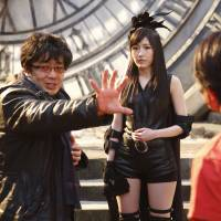 Pulling punches: Renowned samurai-film director Keishi Otomo choreographs fight scenes with AKB48 for 'Bokutachi wa Tatakawanai' ('We Won't Fight'). | © AKS