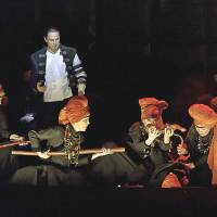 Trouble brewing: Simon Keenlyside, in the title role of 'Macbeth,' encounters the fateful chorus of witches. | CLIVE BARDA