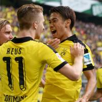 Dortmund's Shinji Kagawa (right), seen in a file photo from earlier this month, scored in the German club's 4-3 win over Norwegian foe Odd on Thursday in a Europa League qualifier. | AFP-JIJI