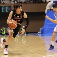 Japan shooting guard Sanae Motokawa, seen in a file photo, scored eight points in a 60-44 win over Taiwan at the FIBA Asia Women's Championship on Monday in Wuhan, China.